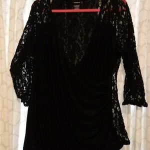 Black long sleeve shirt back is see threw lace